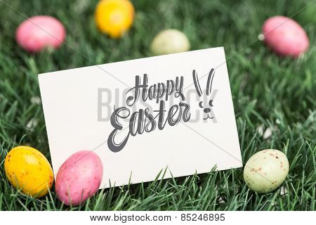 Happy easter against blank greeting card with easter eggs
