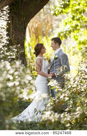 Newly married couple having private moment in the garden
