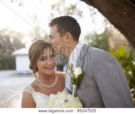 New bride and groom having a fun moment together