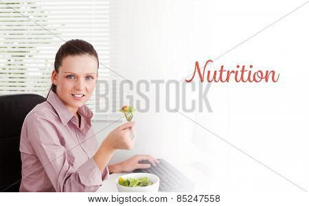 The word nutrition against businesswoman eats salad