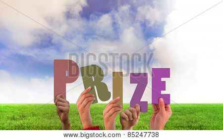 Hands holding up prize against green field