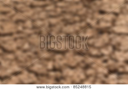 Abstract blurred background of cracked earth, illustrating the drought in California