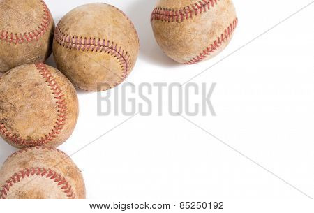 A group of vintage leather baseball on a white background with copy space