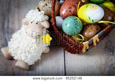 Easter decoration with eggs and cute lamb