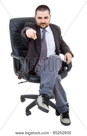 young businessman on a chair, isolated on white