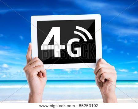 Tablet pc with text 4G with beach background