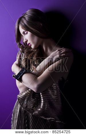 Young sensual girl on purple background