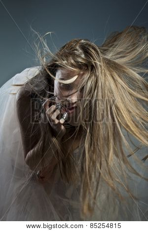 Young beautiful girl with flying hair