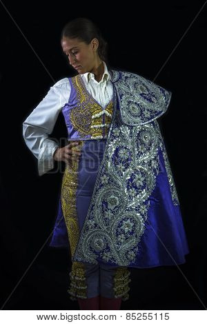 Woman Bullfighter Posing With Capote Walk Purple With Hand On Waist