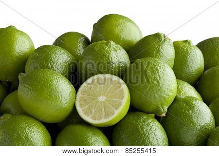 Fresh green limes and a half one