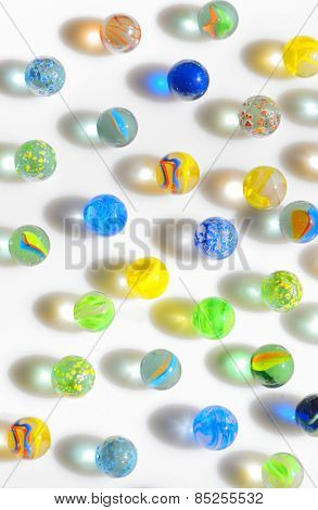Colorful different Marbles on white background