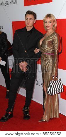 LOS ANGELES - MAR 12:  Brandon Thomas Lee, Pamela Anderson at the