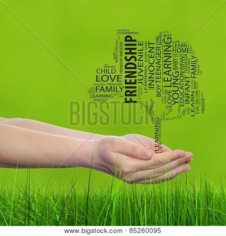 Concept or conceptual black education text word cloud or tagcloud as a tree on man or woman hand on green blur background and grass