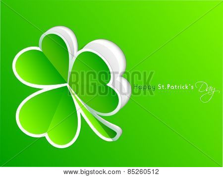 Glossy paper cut out Irish clover leaf on green background for Happy St. Patrick's Day celebration.
