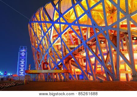 BEIJING, CHINA - APR 7: Beijing National Stadium at night on April 7, 2013 in Beijing, China. The stadium was established for the 2008 Summer Olympics and Paralympics.