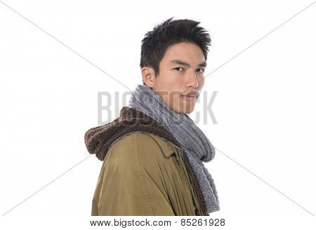 Fashion Shot of a young man in coat. He is now a professional model