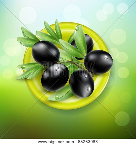background with black olives on a green plate