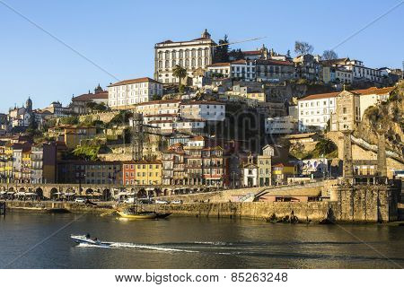 PORTO, PORTUGAL - CIRCA FEB, 2015: Ribeira, traditional boats at Douro river in Old Town. In 1996, UNESCO recognised Old Town of Porto as a World Heritage Site.