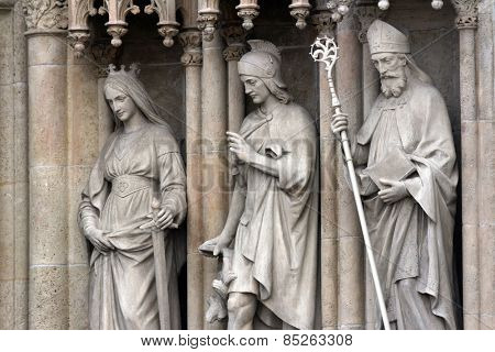 ZAGREB, CROATIA - SEP 25, 2013: statue of Saints Catherine, Florian, Cyril on the portal of the cathedral dedicated to the Assumption of Mary and to kings Saint Stephen and Saint Ladislaus in Zagreb