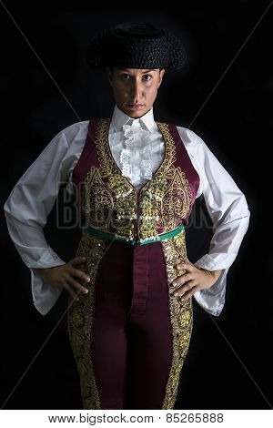 Woman Bullfighter By Dressing In A Costume Of Old Lighting On A Black Background