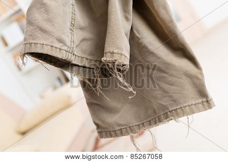 very old ripped worn trousers