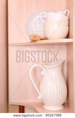 Tableware on wooden shelves