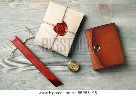 Hand made leather man wallet and  package on wooden background