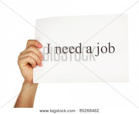 Sheet of paper with inscription I need a job in male hand isolated on white