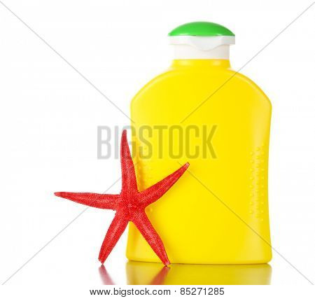 Bottle of suntan cream with sea star isolated on white