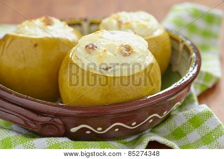 Baked apple stuffed with cream cheese