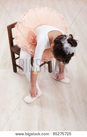 Seated Dancer Adjusting Her Shoes