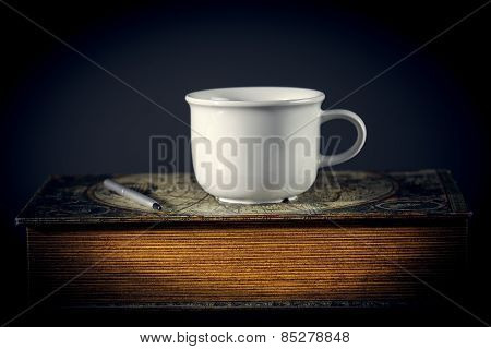Still Life With Book And Cup Of Tea
