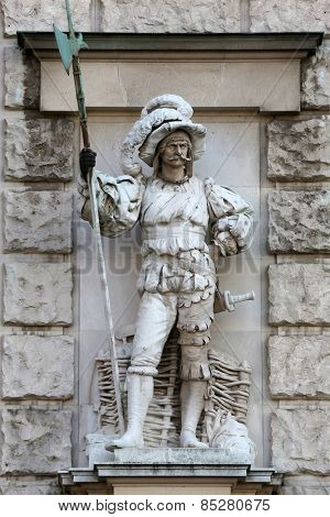 VIENNA, AUSTRIA - OCTOBER 10: Anton Schmidgruber: Landsknecht, on the facade of the Neuen Burg on Heldenplatz in Vienna, Austria on October 10, 2014.