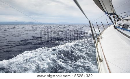 Sailing ship yachts in the sea in stormy weather. Yachting.