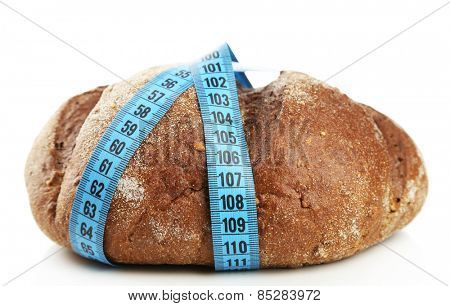 Fresh bread with measuring tape, isolated on white - diet concept