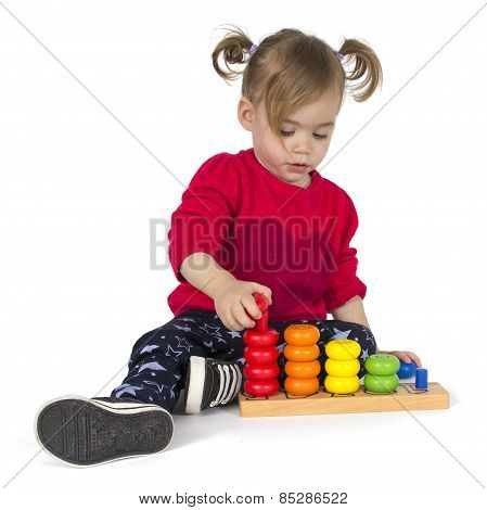 Baby girl playing with rings toy