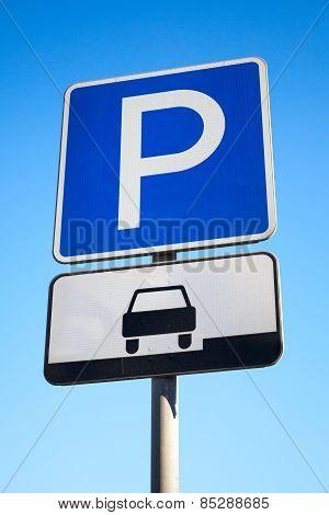 Blue Parking Road Sign On Blue Sky Background