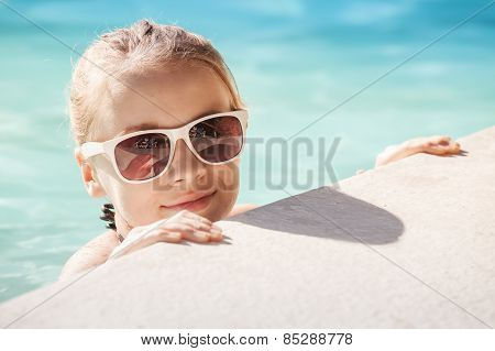 Blond Girl With Sunglasses In Pool, Summer Portrait