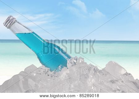 Beer Bottle On Ice Cube At Beach