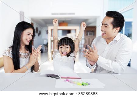Cheerful Girl Get Appreciation From Her Parents