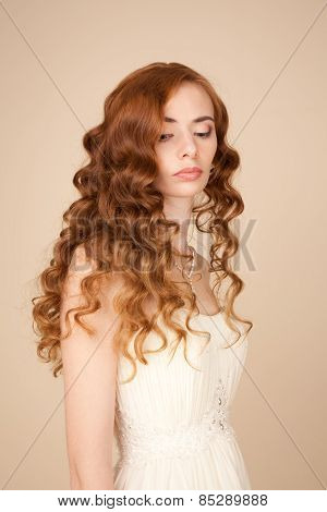 Portrait Of Bride With Curly Hairstyle And Beautiful Makeup