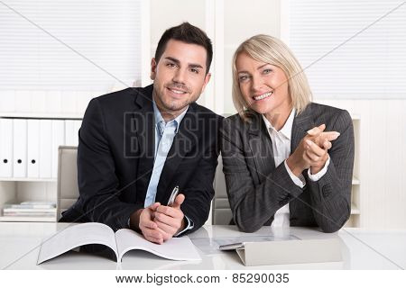Happy male and female business team sitting in the office. Successful collaboration or partnership,
