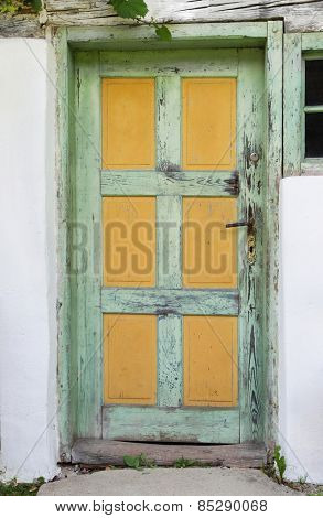 Old wooden door of an ancient farmhouse.