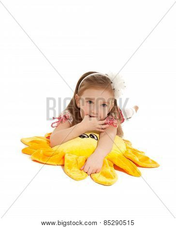 Little Girl With Toy Lying On The Floor Isolated