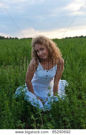 Picture Of Beautiful Woman Sitting On Grass
