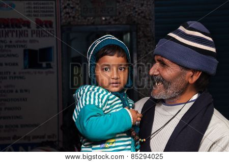 Indian Grandfather With His Granddaughter On The Street In Agra