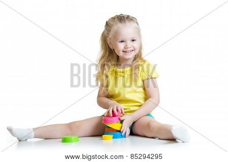 child little girl playing with color toys