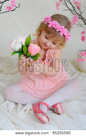 The Girl In A Pink Dress And A Wreath On His Head