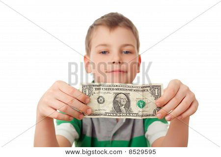 Smiling Boy Holds One Dollar In Both Hands  Isolated On White Background