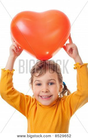 Laughing Little Girl Holds Over Her Head Heart Shape Balloon Isolated On White Background